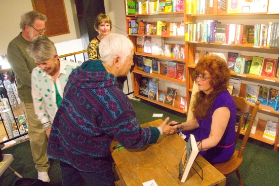 Author Mitzi Loftus shakes hands with me at Bloomsbury