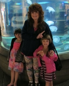 Kayla, right, me, center, Kylie, left. Viewing jelly fish at the Aquarium
