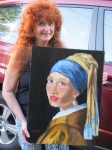 Me holding the portrait I did of the 'Girl With the Pearl Earring""