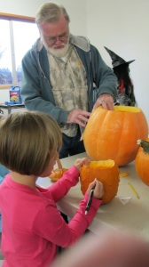 My husband, Joe, and Kylie carving Halloween pumpkins